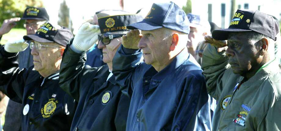 Veterans of World War II, the Korean War and the Vietnam War stand proudly together during New Milford's Veterans Day ceremony on the south end of the Village Green in New Milford. Nov. 11, 2013 Photo: Norm Cummings / The News-Times