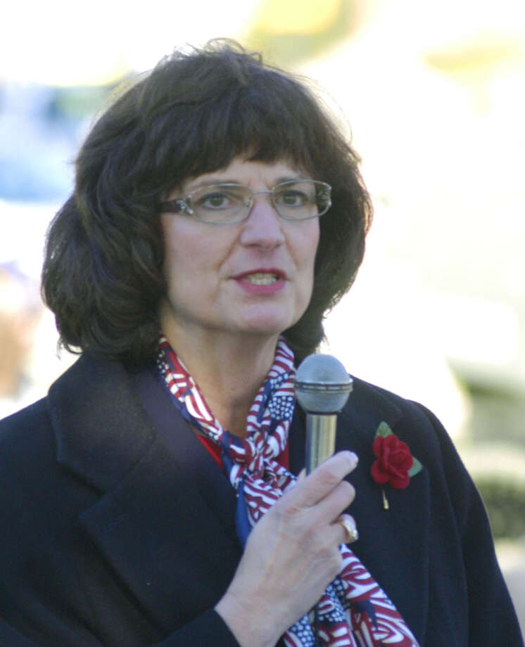State Rep. Cecilia Buck-Taylor (R-60th) contributes her strong message of support for our nation's military and its veterans during New Milford's Veterans Day ceremony on the south end of the Village Green in New Milford. Nov. 11, 2013 Photo: Norm Cummings / The News-Times