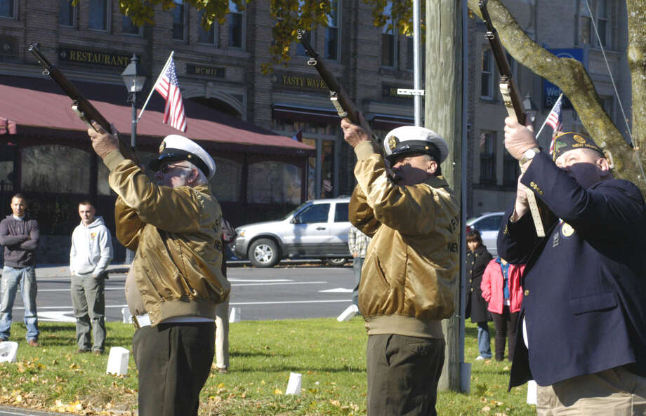 The honor guard climaxes New Milford's Veterans Day ceremony on the south end of the Village Green with its gun salute. Nov. 11, 2013 Photo: Norm Cummings / The News-Times