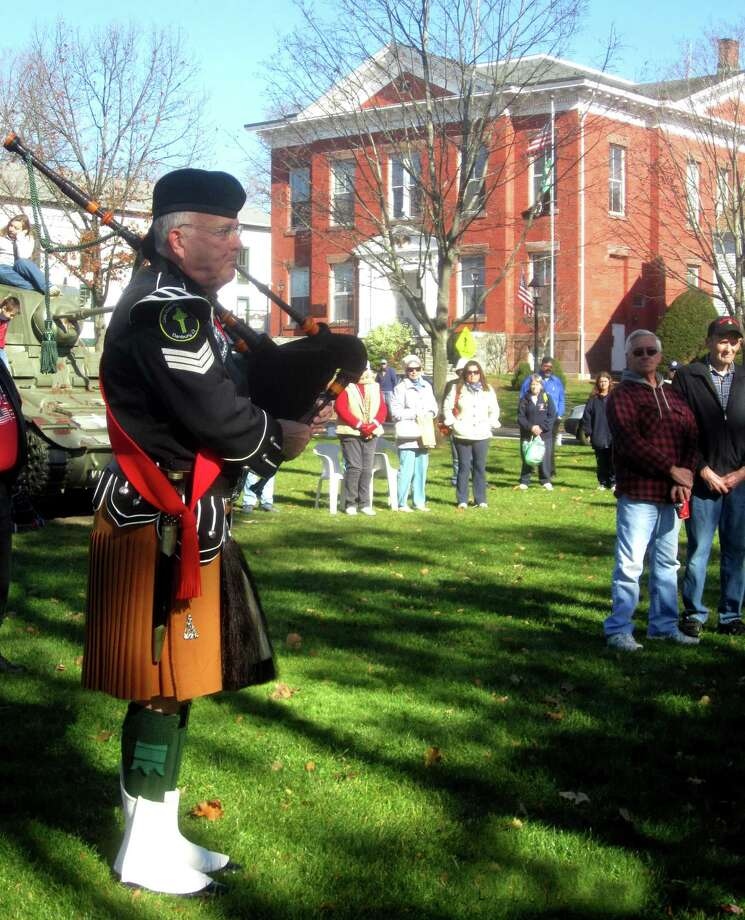 "A bagpipe rendition of ""Amazing Grace"" by New Milford's Pat Maguire stirs the feelings of the several hundred on hand for New Milford's Veterans Day ceremony on the south end of the Village Green in New Milford. Nov. 11, 2013 Photo: Norm Cummings / The News-Times"