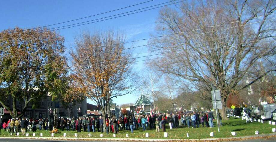 Hundreds are on hand to pay tribute during New Milford's Veterans Day ceremony on the south end of the Village Green in New Milford. Nov. 11, 2013 Photo: Norm Cummings / The News-Times