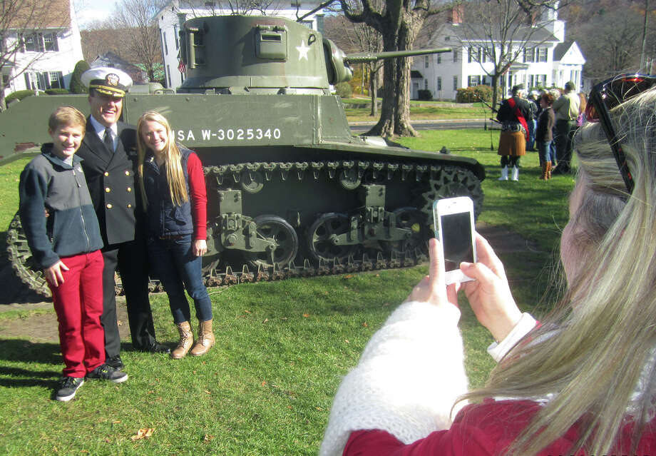 The Brofford family captures a memory following New Milford's Veterans Day ceremony. Nov. 11, 2013 Photo: Norm Cummings / The News-Times