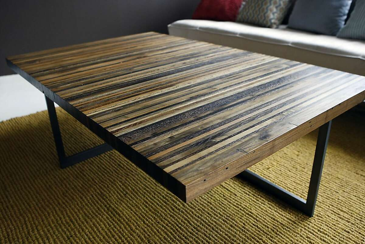 BA Design's PALLETform Coffee Table is seen on display in the home of designer Branden Allen and his wife Jennifer Ivanovich in Oakland, CA Thursday, October 24, 2013. BA Design's founder and lead designer Branden Adams and his wife, landscape designer Jennifer Ivanovich will have a number of furniture pieces featured in a new exhibition, New West Coast Design 2, at the SF Museum of Design and Craft.