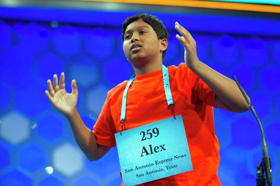 """Alex Iyer, 14, from San Antonio, Texas, reacts after misspelling """"savate"""" during the finals of the 90th Scripps National Spelling Bee in Oxon Hill, Md., Thursday, June 1, 2017.  (AP Photo/Cliff Owen) Photo: Cliff Owen, Associated Press / FR170079 AP"""