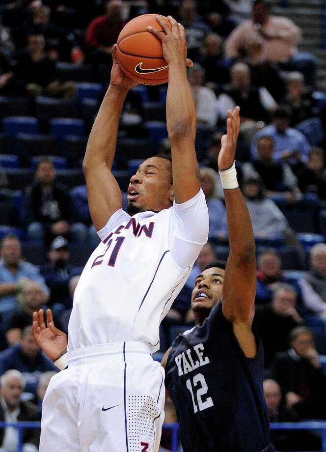Connecticut's Omar Calhoun (21) grabs a rebound from Yale's Armani Cotton during the second half of an NCAA college basketball game, in Hartford, Conn., on Monday, Nov. 11, 2013. Calhoun scored a game-high 18 points in Connecticut's 80-62 victory. Photo: Fred Beckham, AP / Associated Press