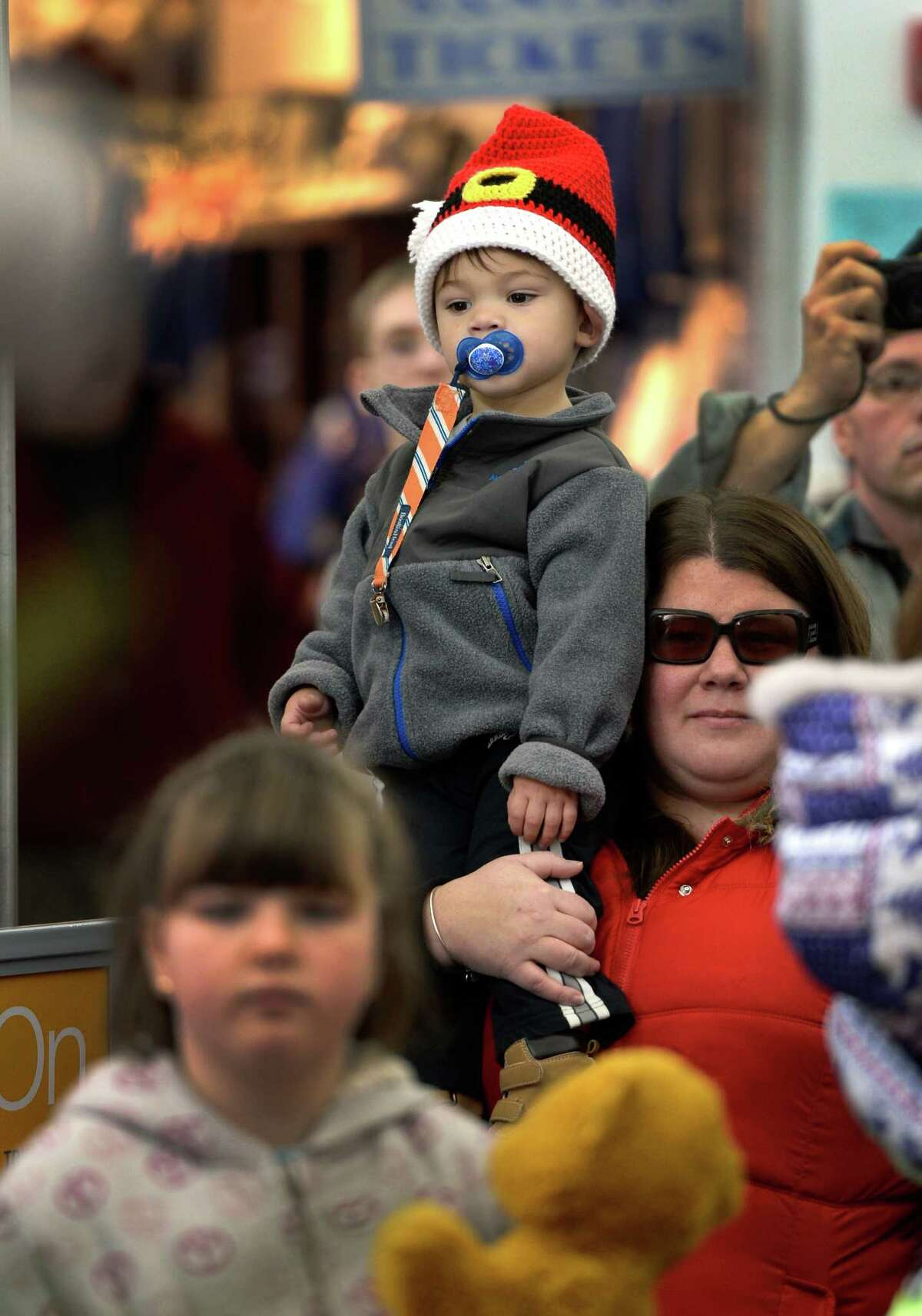 Two-year old Carter Fernandez is held by his mother, Jessica, as they watch the kick-off for this years Saratoga & North Creek Railroad Polar Express Monday afternoon, Nov. 11, 2013, at the Saratoga train station in Saratoga Springs, N.Y. (Skip Dickstein/Times Union)