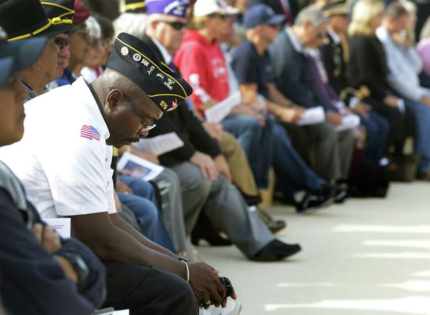 Richard D. Henry III, retired Air Force Veteran, contemplates the service during the Veterans Day Ceremony at Fort Sam Houston National Cemetery, Monday, Nov. 11, 2013.