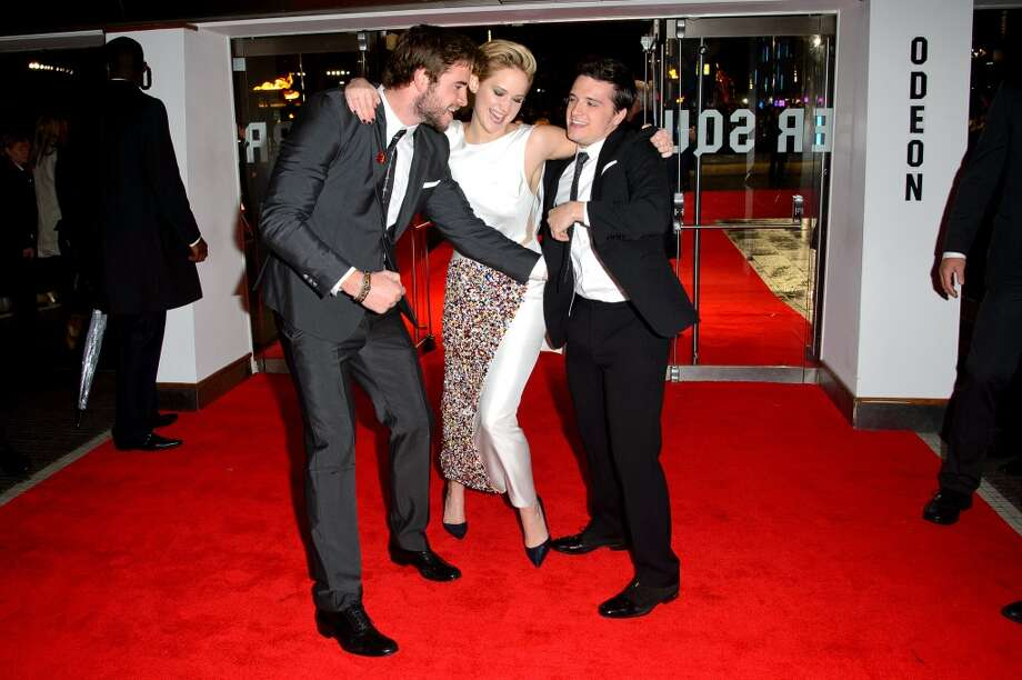 "(L-R) Liam Hemsworth, Jennifer Lawrence and Josh Hutcherson attends the UK Premiere of ""The Hunger Games: Catching Fire"" at Odeon Leicester Square on November 11, 2013 in London, England. Photo: Dave J Hogan, Getty Images"