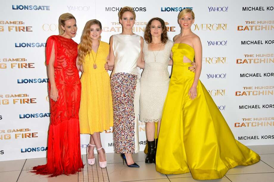 "(L-R) Jena Malone, Willow Shields, Jennifer Lawrence, Nina Jacobson and Elizabeth Banks attends the UK Premiere of ""The Hunger Games: Catching Fire"" at Odeon Leicester Square on November 11, 2013 in London, England. Photo: Dave J Hogan, Getty Images"