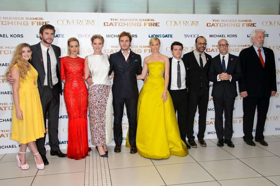 "(L-R) Willow Shields, Liam Hemsworth, Jena Malone, Jennifer Lawrence, Sam Claflin, Elizabeth Banks, Josh Hutcherson, Jeffrey Wright, Stanley Tucci and Donald Sutherland attends the UK Premiere of ""The Hunger Games: Catching Fire"" at Odeon Leicester Square on November 11, 2013 in London, England. Photo: Dave J Hogan, Getty Images"