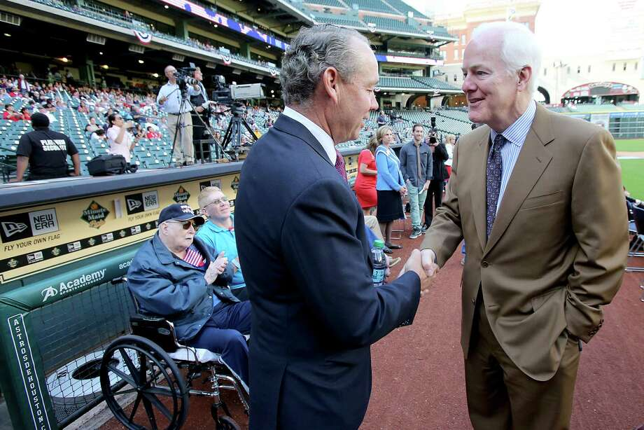 11/11/13: From left to right, Astros owner Jim Crane shakes hands with US Senator John Cornyn while attending the Veterans Day -November 11, 2013, Salute to Veterans at Minute Maid Park in Houston, Texas. Photo: Thomas B. Shea, For The Chronicle / © 2013 Thomas B. Shea