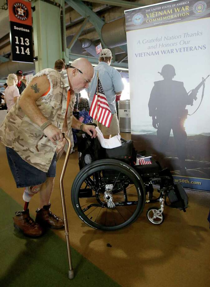 11/11/13: Marine Corp. Al Perdew who received one of the first bionic legs in 2006 attends the the Veterans Day -Novemeber 11, 2013, Salute to Veterans at Minute Maid Park in Houston, Texas. Photo: Thomas B. Shea, For The Chronicle / © 2013 Thomas B. Shea