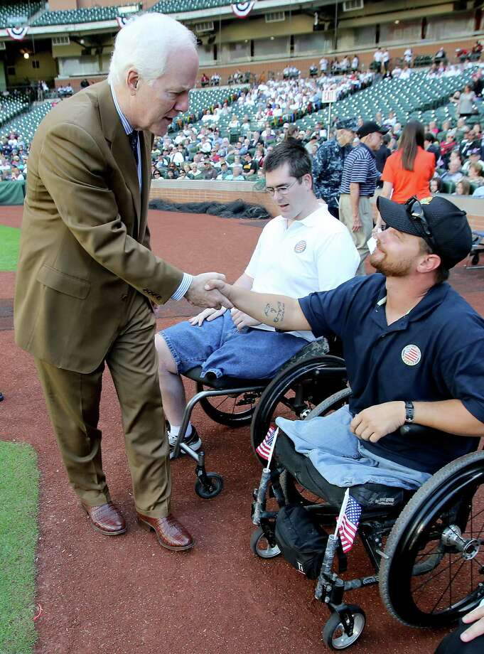 11/11/13: US Senator John Cornyn shakes hands Army Staff Sgt. Kyle Malin at the Veterans Day -November 11, 2013, Salute to Veterans at Minute Maid Park in Houston, Texas. Photo: Thomas B. Shea, For The Chronicle / © 2013 Thomas B. Shea