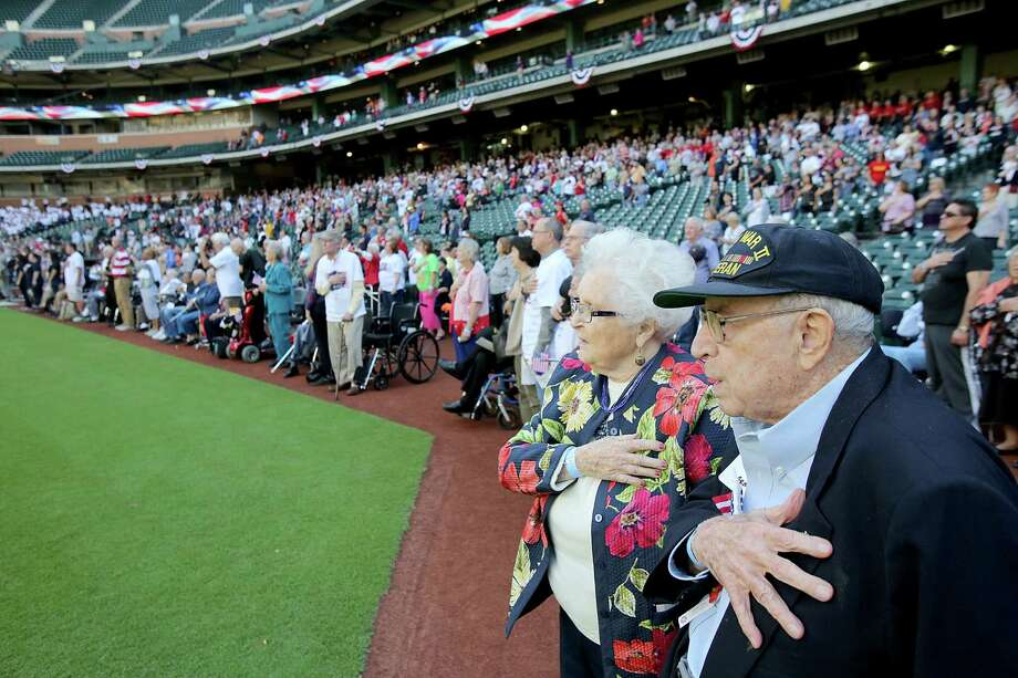 11/11/13: Corp. Stanley Sanders and his wife Majorie Sanders stand for the National Anthem at the Veterans Day -November 11, 2013, Salute to Veterans at Minute Maid Park in Houston, Texas. Photo: Thomas B. Shea, For The Chronicle / © 2013 Thomas B. Shea