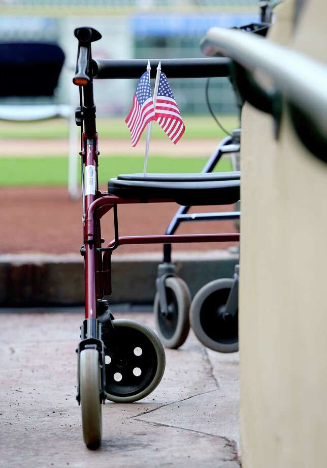 11/11/13: American Flags are seen sticking out of a walker at the Veterans Day -Novemeber 11, 2013, Salute to Veterans at Minute Maid Park in Houston, Texas. Photo: Thomas B. Shea, For The Chronicle / © 2013 Thomas B. Shea