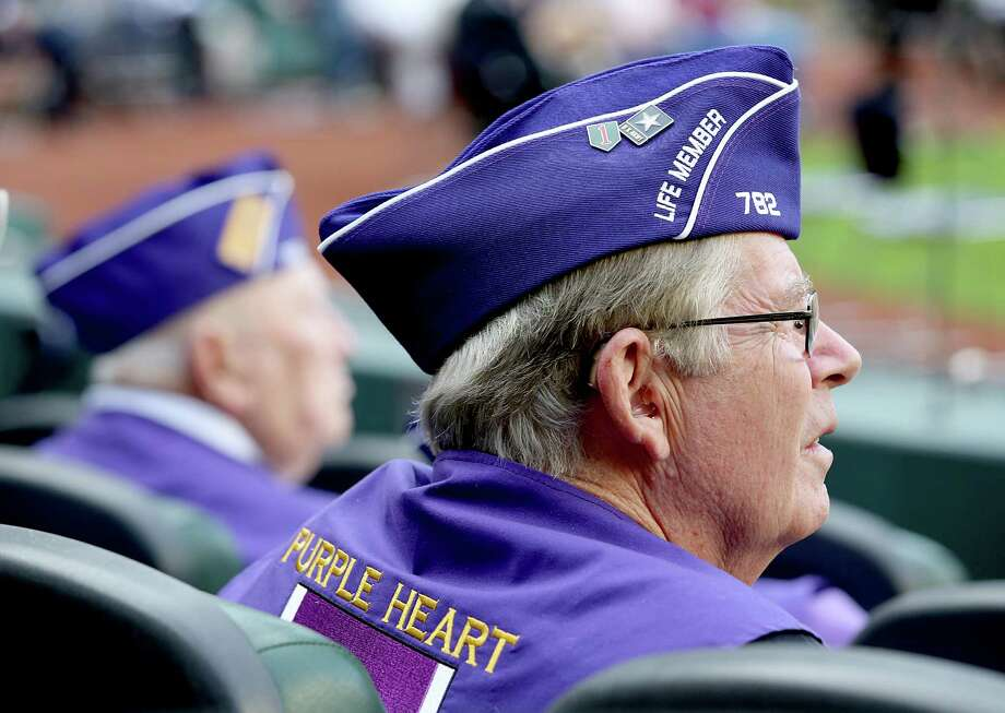 11/11/13: Veterans watch the featured film ; Honor Flight: One Last Mission at the Veterans Day -November 11, 2013, Salute to Veterans at Minute Maid Park in Houston, Texas. Photo: Thomas B. Shea, For The Chronicle / © 2013 Thomas B. Shea