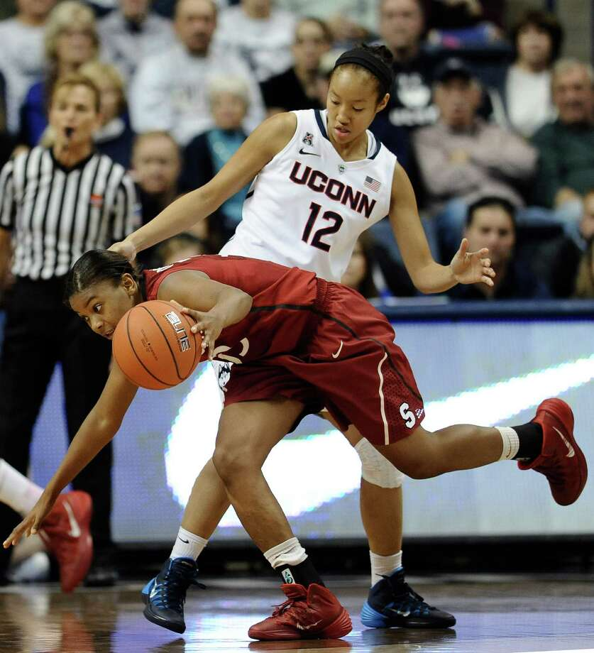 Stanford's Amber Orrange, front, maneuvers past Connecticut's Saniya Chong during the first half of an NCAA college basketball game, Monday, Nov. 11, 2013, in Storrs, Conn.  Orrange was top scorer for Stanford with 22 points. Connecticut won 76-57. Photo: Jessica Hill, AP / Associated Press