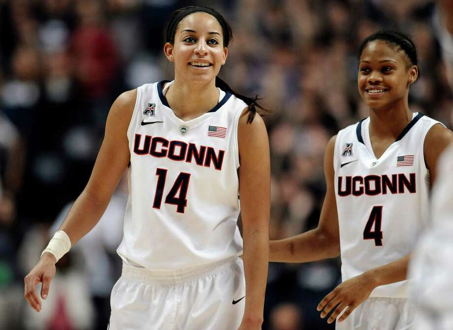 Connecticut's Bria Hartley and Moriah Jefferson smile during the second half of an NCAA college basketball game, Monday, Nov. 11, 2013, in Storrs, Conn. Connecticut won 76-57. Photo: Jessica Hill, AP / Associated Press