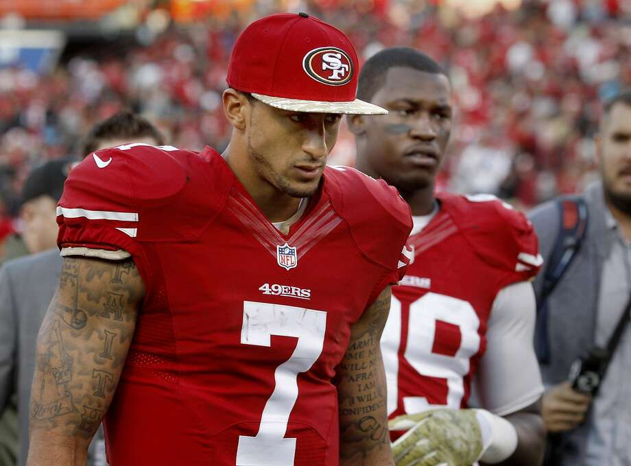Colin Kaepernick (7) and Aldon Smith walked off the field after the loss Sunday November 10, 2013. The San Francisco 49ers were beaten by the Carolina Panthers 10-9 at Candlestick Park. Photo: Brant Ward, The Chronicle