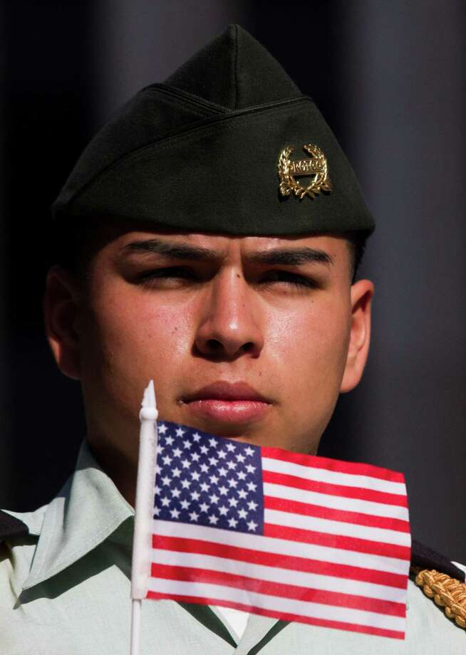 A member of the Furr HIgh School Junior ROTC marches with an American Flag during the annual City of Houston Veterans Day parade on Monday, Nov. 11, 2013, in Houston.  The celebration also included a Veterans job and health fair. Photo: J. Patric Schneider, For The Chronicle / © 2013 Houston Chronicle