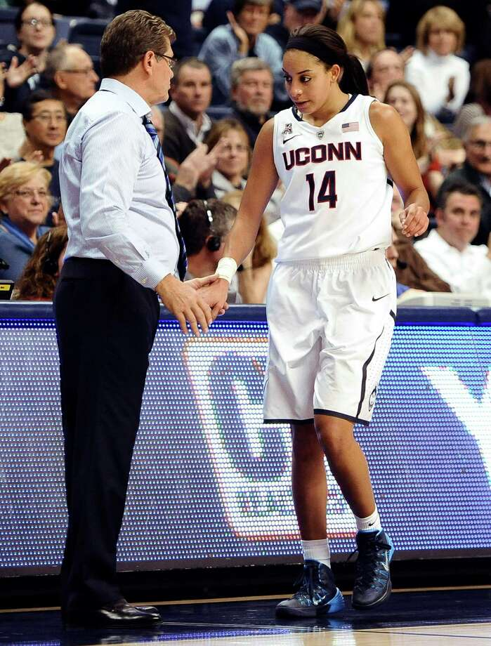 Connecticut's Bria Hartley, right, is greeted by Connecticut head coach Geno Auriemma during the second half of an NCAA college basketball game, Monday, Nov. 11, 2013, in Storrs, Conn. Hartley was top scorer for Connecticut with 20 points. Connecticut won 76-57. Photo: Jessica Hill, AP / Associated Press