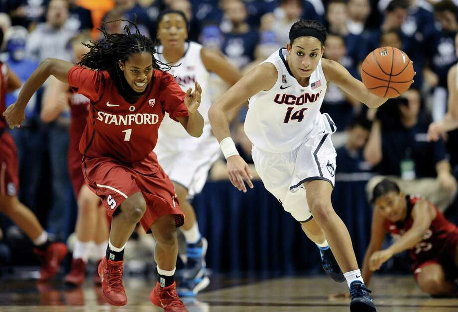 Connecticut's Bria Hartley, right, steals the ball from Stanford's Lili Thompson, left, during the second half of an NCAA college basketball game, Monday, Nov. 11, 2013, in Storrs, Conn. Hartley was top scorer for Connecticut with 20 points. Connecticut won 76-57. Photo: Jessica Hill, AP / Associated Press