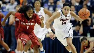 Connecticut's Bria Hartley, right, steals the ball from Stanford's Lili Thompson, left, during the second half of an NCAA college basketball game, Monday, Nov. 11, 2013, in Storrs, Conn. Hartley was top scorer for Connecticut with 20 points. Connecticut won 76-57.
