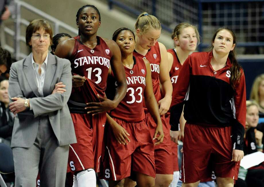 Stanford players and Stanford head coach Tara VanDerveer, right, get up from the bench at the end of an NCAA college basketball game against Connecticut, Monday, Nov. 11, 2013, in Storrs, Conn. Connecticut won 76-57. Photo: Jessica Hill, AP / Associated Press