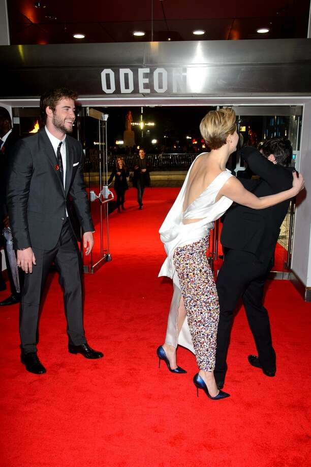 """(L-R) Liam Hemsworth, Jennifer Lawrence and Josh Hutcherson attends the UK Premiere of """"The Hunger Games: Catching Fire"""" at Odeon Leicester Square on November 11, 2013 in London, England. Photo: Dave J Hogan, Getty Images"""