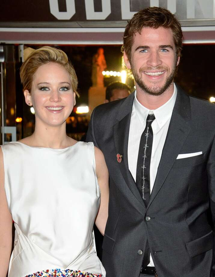 "(L-R) Jennifer Lawrence and Liam Hemsworth attend the UK Premiere of ""The Hunger Games: Catching Fire"" at Odeon Leicester Square on November 11, 2013 in London, England. Photo: Dave J Hogan, Getty Images"