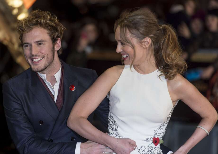 "Laura Haddock and Sam Claflin attend the UK Premiere of ""The Hunger Games: Catching Fire"" at Odeon Leicester Square on November 11, 2013 in London, England. Photo: Mark Cuthbert, UK Press Via Getty Images"