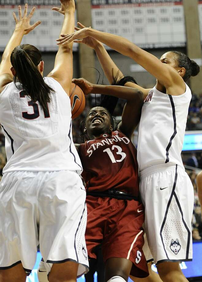 Connecticut's Stefanie Dolson, left, and Kiah Stokes, right, stop Stanford's Chiney Ogwumike, center, during the first half of an NCAA college basketball game, Monday, Nov. 11, 2013, in Storrs, Conn. (AP Photo/Jessica Hill) Photo: Jessica Hill, Associated Press