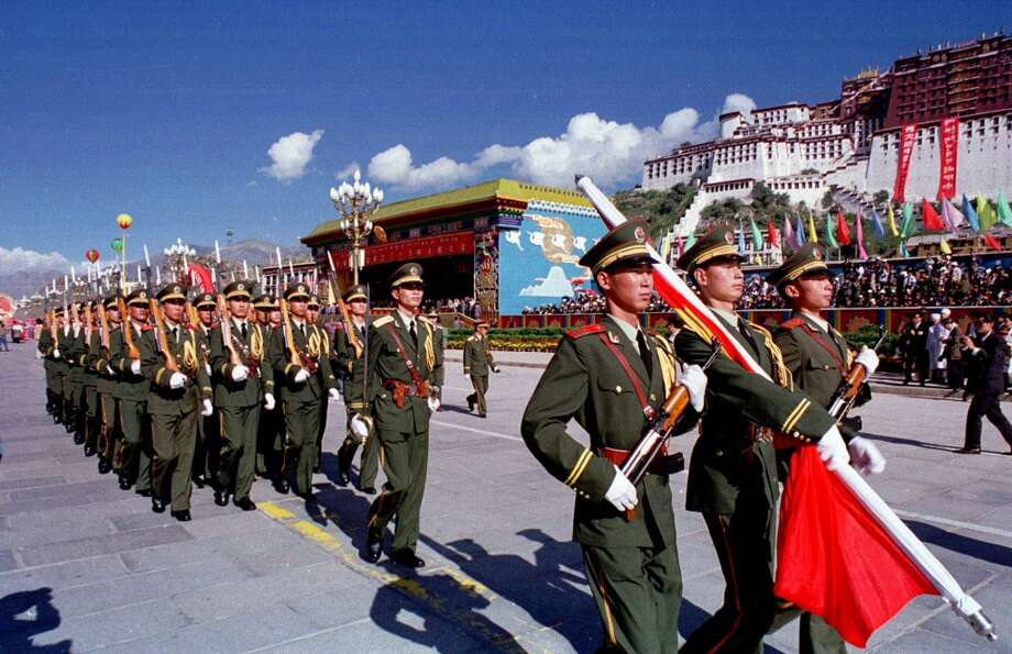 "1 - Sticks a ""Keep China in Tibet"" bumper sticker on official limo Photo: Peter Rogers, Getty Images"