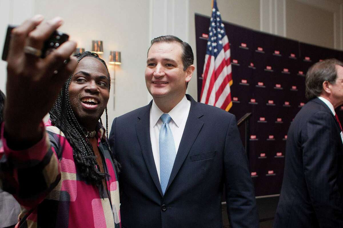 Jerold LaBeaux takes a picture of himself and Sen. Ted Cruz after Cruz spoke during the Greater Houston Partnership's State of Senate lunch event at the Westin Galleria on Monday.
