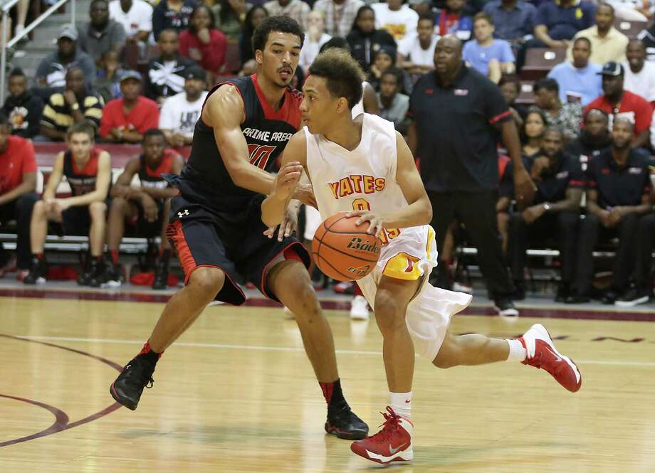 11/11/13: Yates Lion Milton Jackson (0) dribbles past Dallas Prime Prep Spartan Micah Seaborn (10) in a non district high school basketball game at M.O. Campbell Education Center in Aldine, Texas. Photo: Thomas B. Shea, For The Chronicle / © 2013 Thomas B. Shea