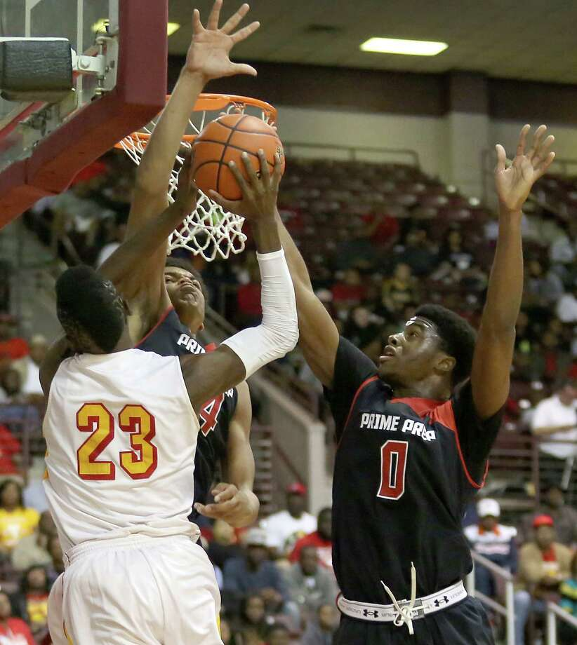 11/11/13: Yates Lion Melvin Swift (23 shot is blocked by Dallas Prime Prep Spartan Andrean Johnson (24) and Emmanuel Mudiay (0) in a non district high school basketball game at M.O. Campbell Education Center in Aldine, Texas. Photo: Thomas B. Shea, For The Chronicle / © 2013 Thomas B. Shea