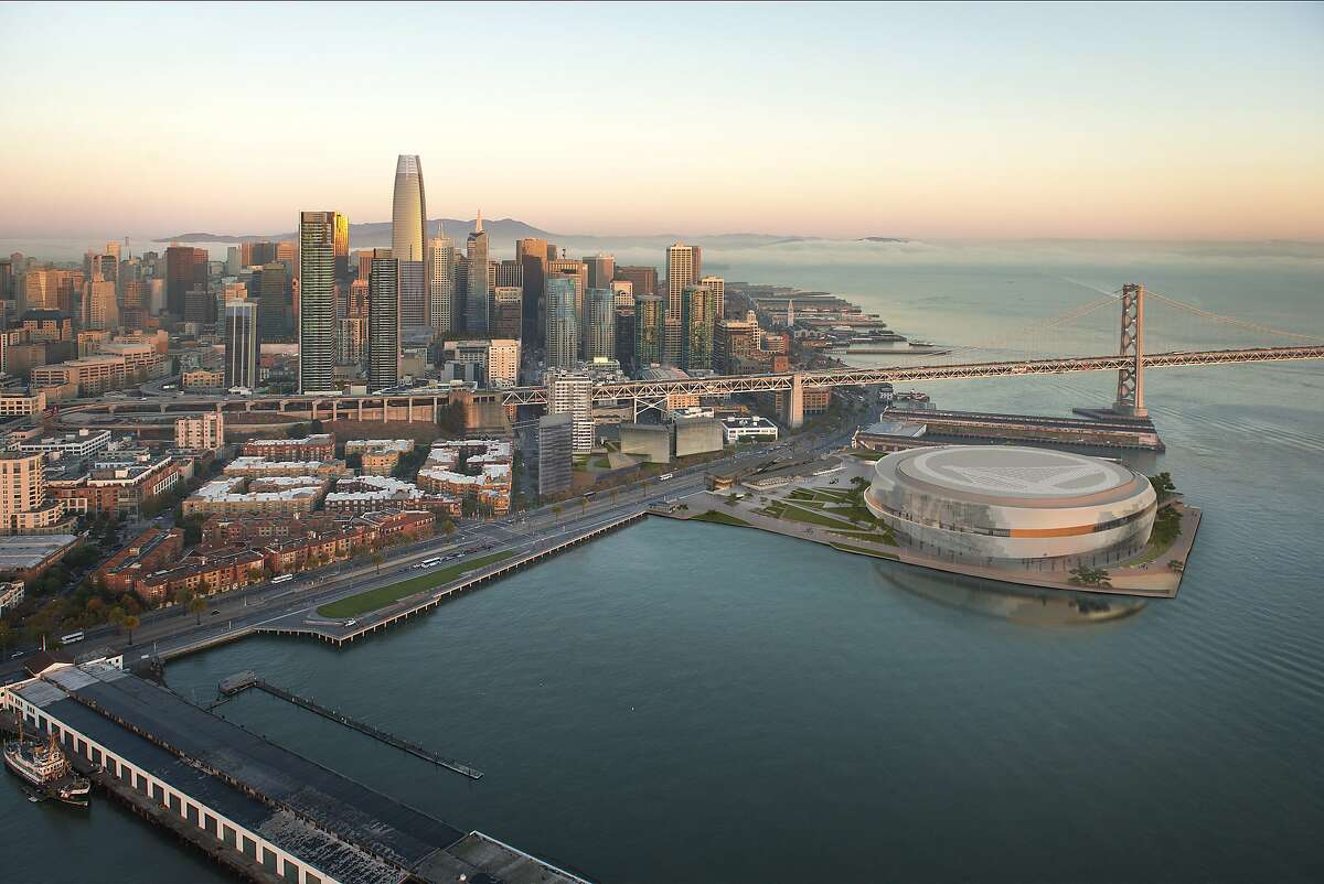 Aerial view of the Golden State Warriors proposed arena and neighboring development across the Embarcadero. The team's redesign being released Tuesday includes trimming the perimeter height of the arena and lowering public plazas to make them more welcoming to pedestrians.