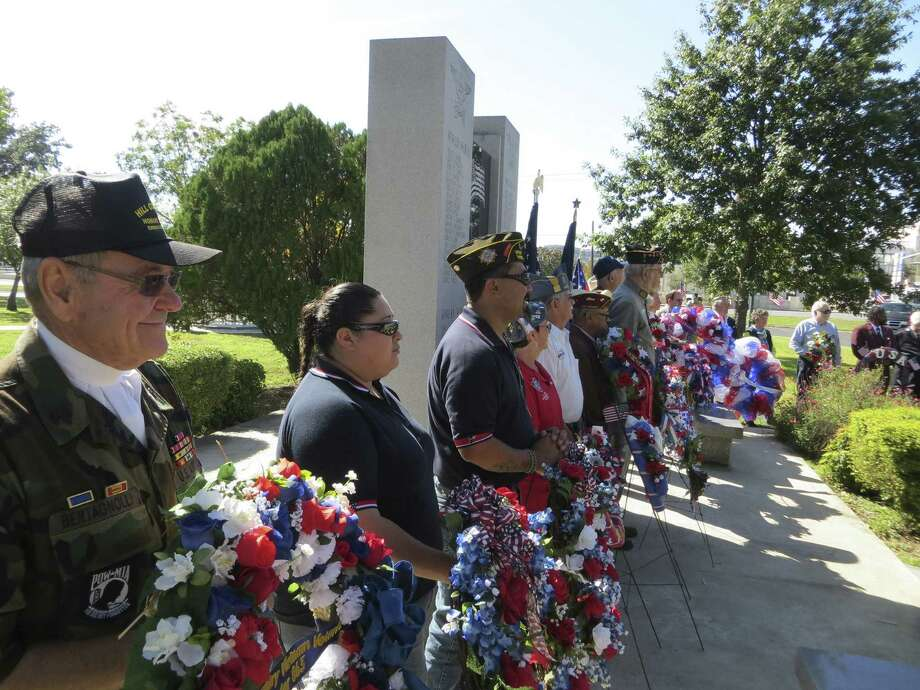 Military and civic groups from around Kerr County placed wreaths at the memorial to fallen service members in Kerrville. Photo: Zeke MacCormack, San Antonio Express-News