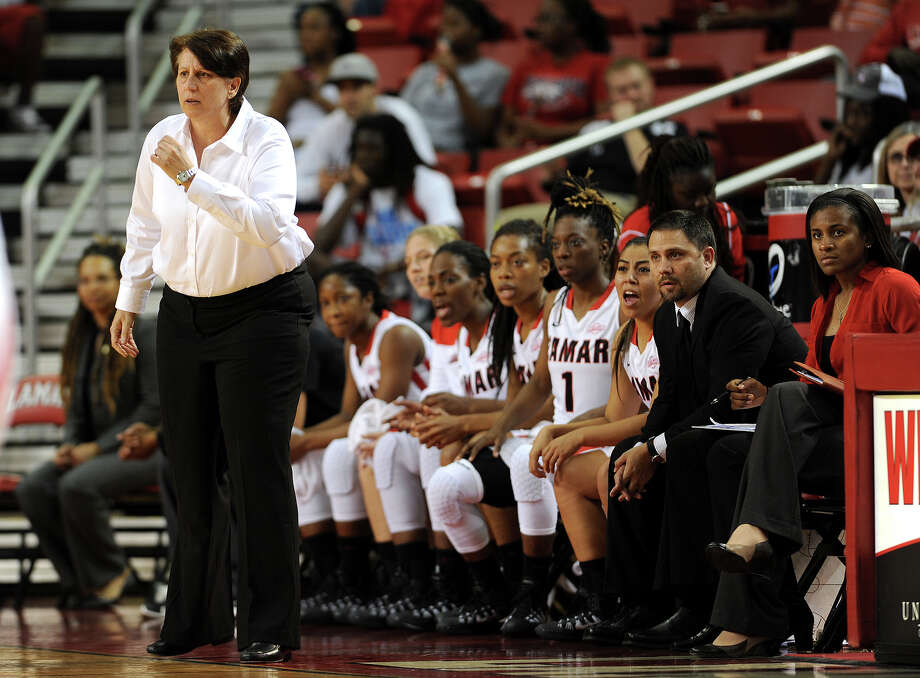Lamar's Robin Harmony coaches the Lady Cards against  Our Lady of the Lake during the team's first home game of the season. The Cards won 94-60. Photo taken Monday, November 11, 2013 Guiseppe Barranco/@spotnewsshooter Photo: Guiseppe Barranco, Photo Editor