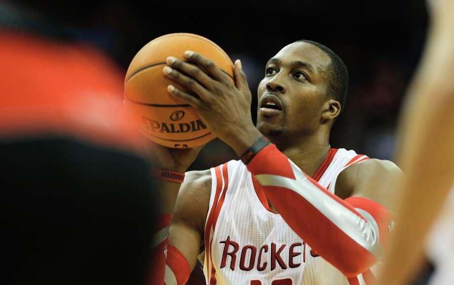 Nov. 11: Rockets 110, Raptors 104 (2OT)Rockets center Dwight Howard shoots a free throw against the Raptors. Photo: Scott Halleran, Getty Images