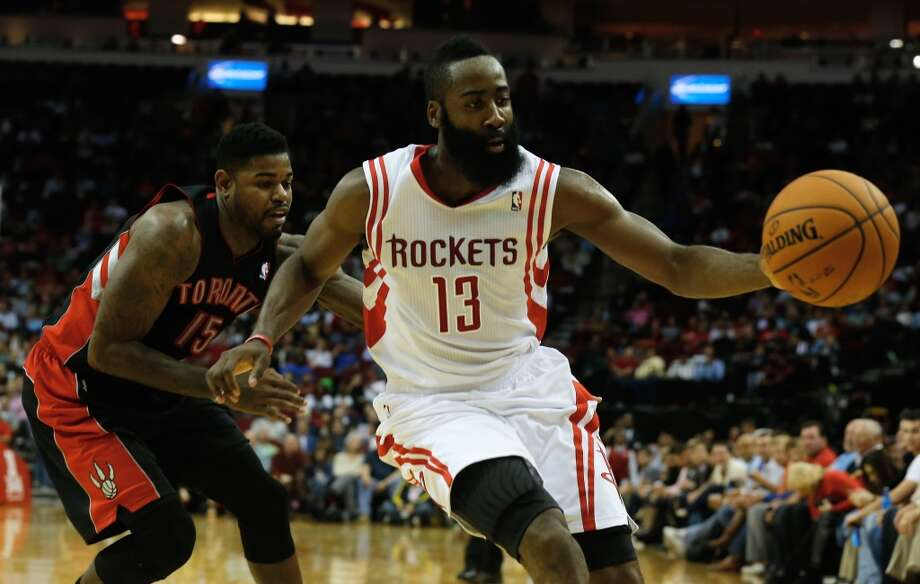 Rockets shooting guard James Harden tries to gain possession of the ball against the Raptors. Photo: Scott Halleran, Getty Images