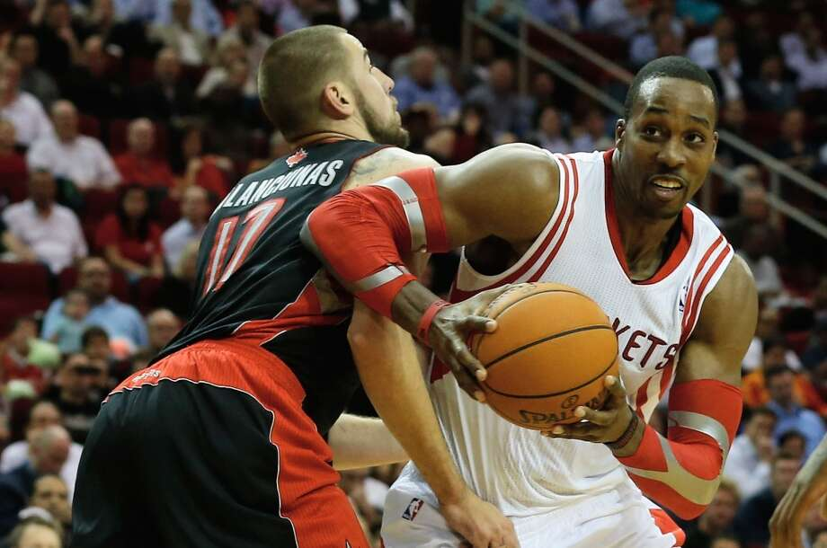 Rockets center Dwight Howard tries to get past Jonas Valanciunas of the Raptors. Photo: Scott Halleran, Getty Images