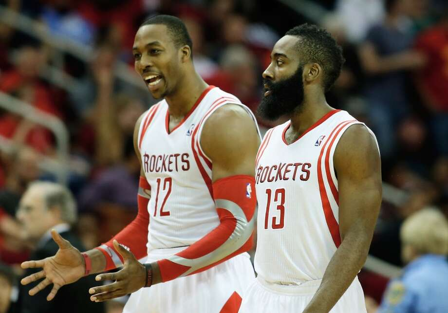 James Harden and Dwight Howard of the Rockets walk off the court during their matchup with the Raptors. Photo: Scott Halleran, Getty Images