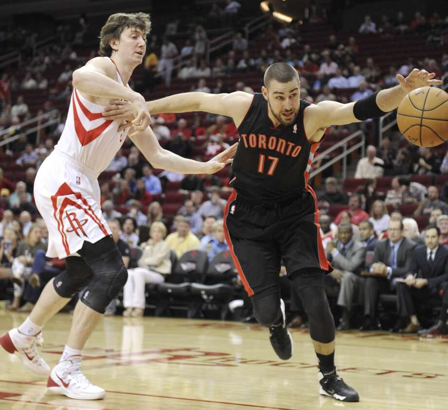 Omer Asik of the Rockets tries to defend Jonas Valanciunas of the Raptors. Photo: Scott Halleran, Getty Images