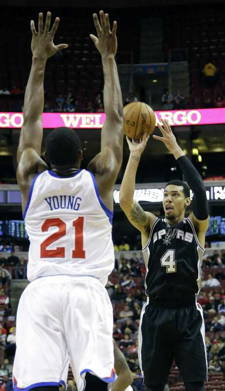 Spurs guard Danny Green unleashes a shot against 76ers forward Thaddeus Young. Green made 5 of 7 attempts from 3-point range and finished with 18 points and seven rebounds.