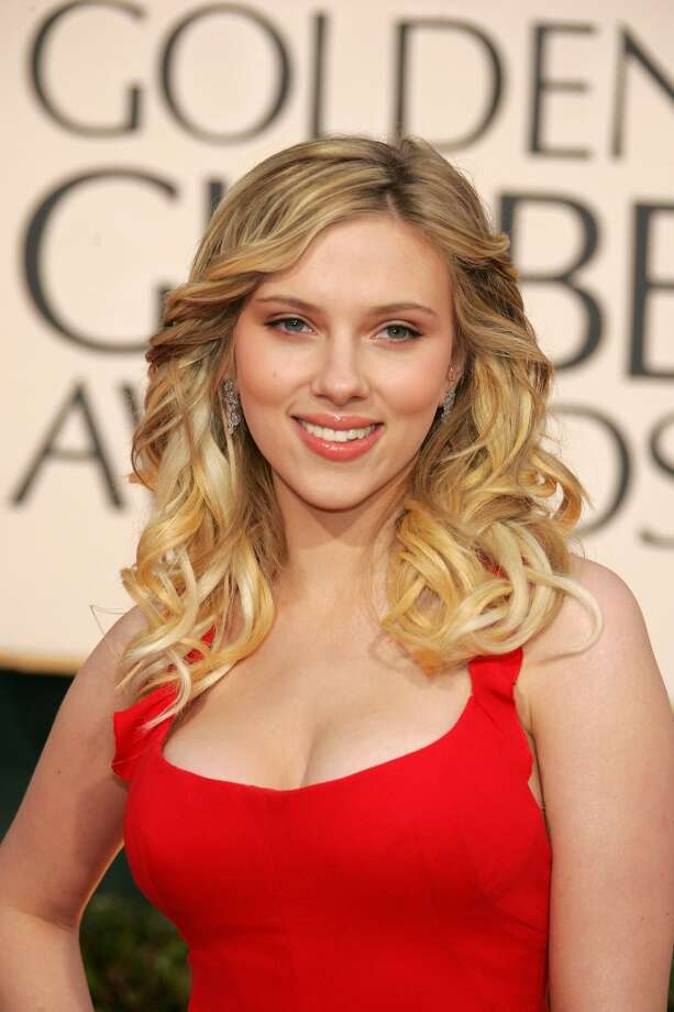 Scarlett Johansson -- her husky smoker's voice allowed her to play adults before she was even an adult. Photo: LUCY NICHOLSON, REUTERS