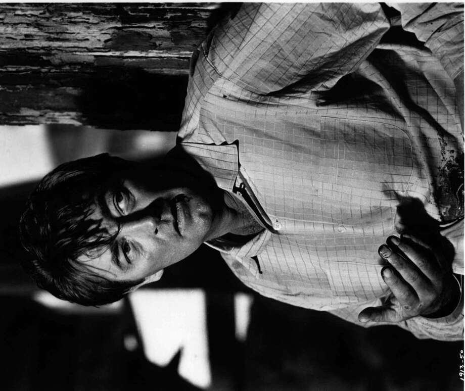 Robert Mitchum -- deep voice, full of dry wit and worldly cynicism. Photo: AP, Universal Studios