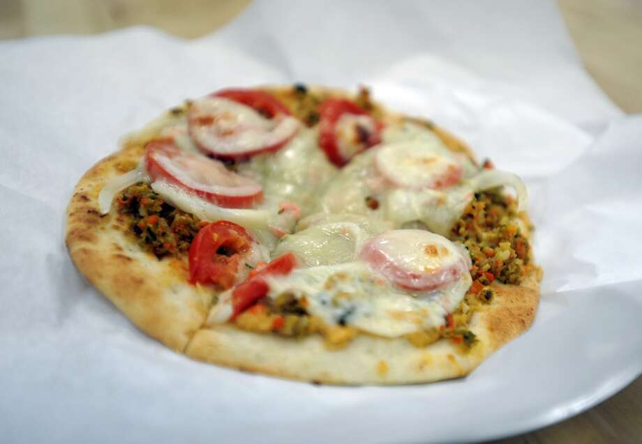 The hummus pizza from Abbie's Imports, an RV parts store, gourmet grocery and Mediterranean deli known for offering a variety of vegetarian dishes. Photo: Cat5