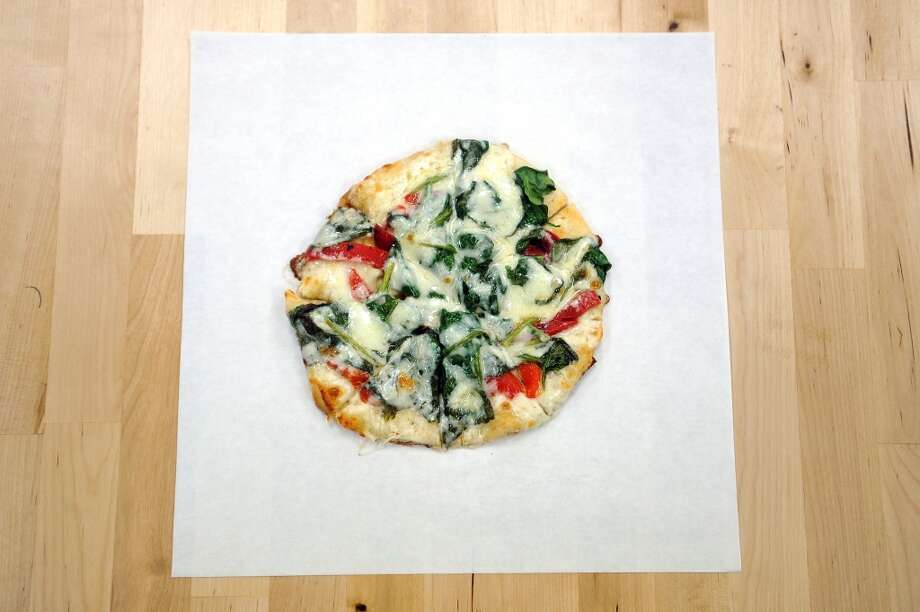 The spinach pizza from Abbie's Imports, an RV parts store, gourmet grocery and Mediterranean deli known for offering a variety of vegetarian dishes. Photo: Cat5