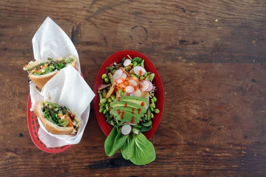 The Ghandi Banh Mon (left) and Super Bowl, two vegetarian options from the Banh Mon Renegade Street Food truck. Photo: Cat5
